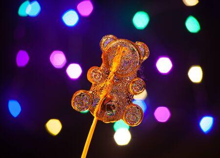 Lollipops on a stick, Dark blurred background with bokeh Standard-Bild