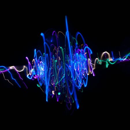 Light drawings on black background. Lines on a spiral .