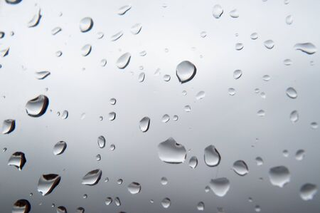 Raindrops on glass close up . Standard-Bild