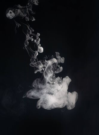 Abstract smoke on a dark background .
