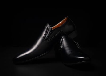 Black shoes on black background .
