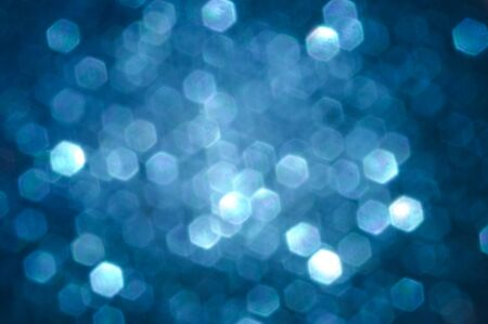 Blue blurred abstract background with bokeh circles .