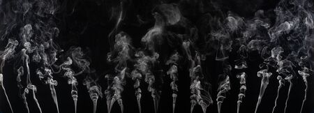 Abstract smoke on a dark background . Isolated .