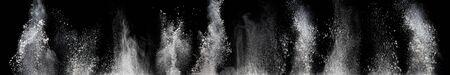 white powder explosion cloud against black background.White dust particles splash .