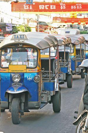 Tuk tuk, or local three wheel taxi, on the streets of Bangkok, Thailand Stock Photo - 782957