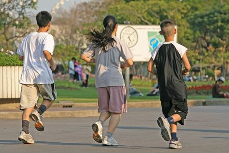 Family running together in a park popular for jogging photo