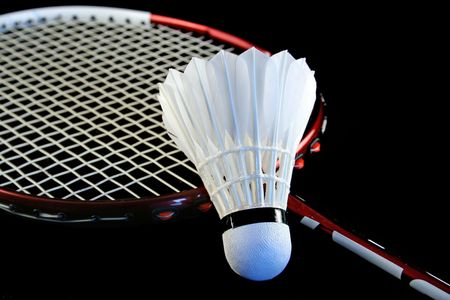 shuttlecock: Badminton racket and shuttlecock isolated on a black background