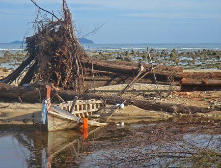 Debris on a beach near Khao Lak, Thailand after the tsunami disaster photo