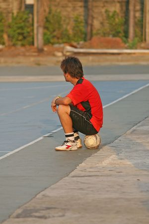 footwork: Player waits for a game of football (soccer)