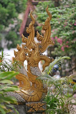 Seven-headed Naga outside Buddhist temple photo