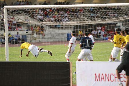 headed: Football (soccer) player makes a headed clearance