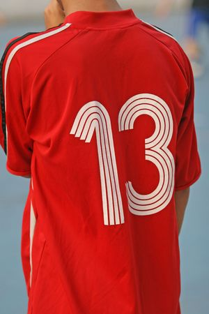 superstitions: Football player wearing a number thirteen shirt