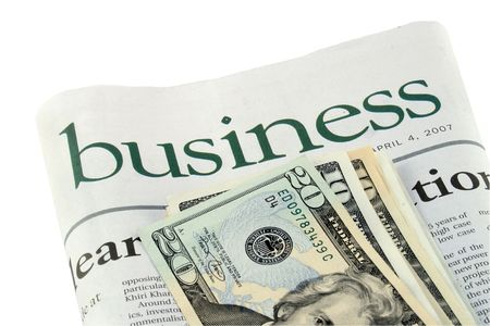 Business section of a newspaper and dollars Stock Photo