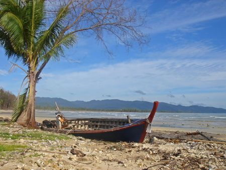 Wreckage of a long tail boat on a beach in Khao Lak, following the tsunami photo