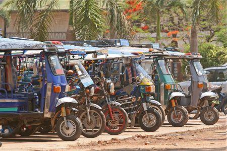 Tuk tuk taxis on the streets of Vientiane, Laos Stock Photo - 871054