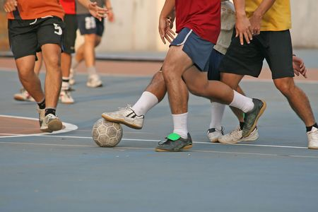 futball: Player makes a tackle during a game of street football