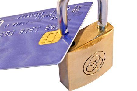 Credit card security showing a padlock and bank card Фото со стока