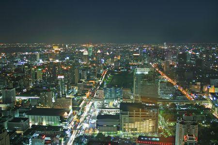 overlooking: Night time scene overlooking downtown Bangkok