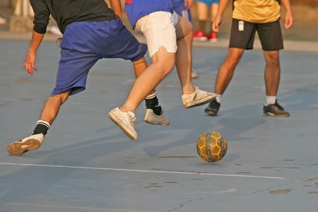 footwork: People enjoying a game of football (soccer)