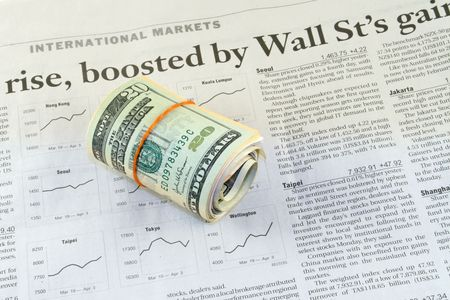 Business section of a newspaper with a globe and dollars Stock Photo - 910521