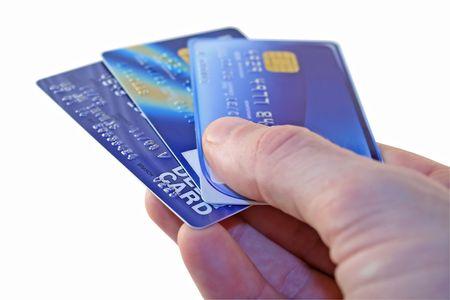 tomar prestado: El hombre manos sobre las tarjetas de cr�dito para el pago
