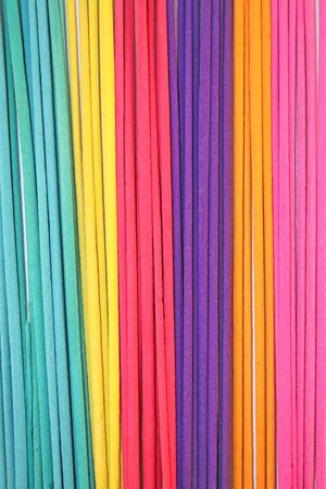 Colorful incense sticks organized as a background photo