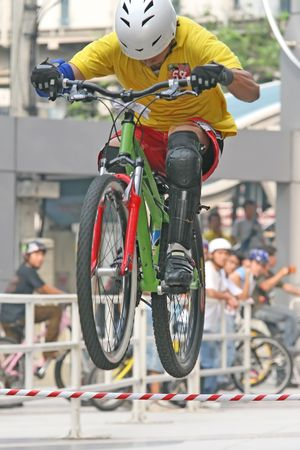 Mountain biker jumps an obstacle during a competition Stock Photo - 929563