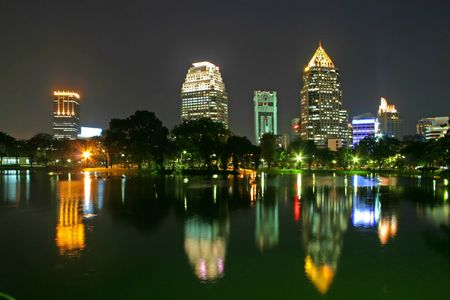 lumpini: View across Lumpini Lake and downtown backdrop in Bangkok, Thailand