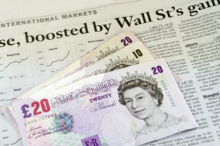 broadsheet: British pounds sterling on the business section of a newspaper