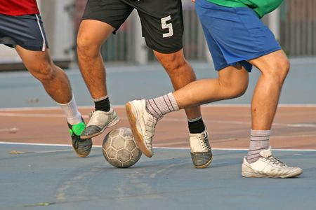 footwork: Close up of a game of street soccer Stock Photo