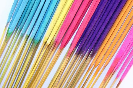 A selection of brightly coloured incense sticks photo