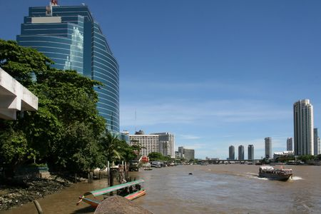 krung: Modern offices and hotels line the Chao Praya River in Bangkok