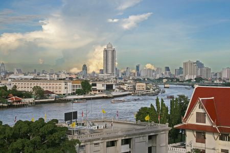 A view across the Chao Praya River and downtown area in Bangkok photo