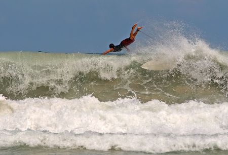 short wave: Surfer takes off on a wave in Thailand Stock Photo