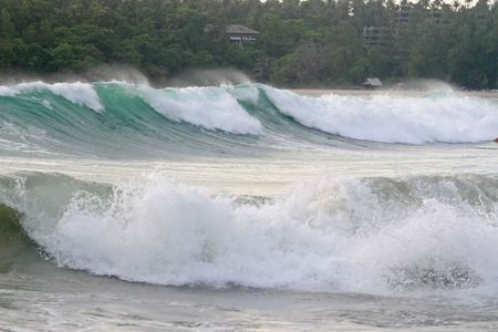 Large waves roll into a tropical beach in Phuket, Thailand photo