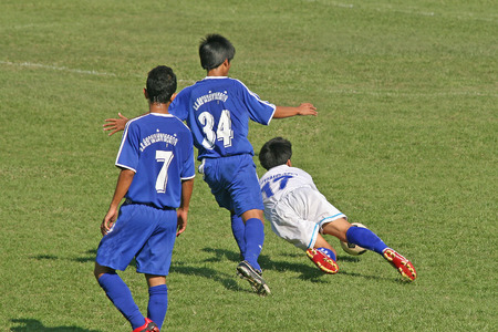 foul: Player commits a foul in a game of soccer