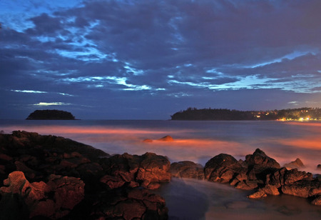 Twilight on a tropical beach in Thailand. Long exposure flattens the waves and gives them a washed out look Stock Photo - 1577474