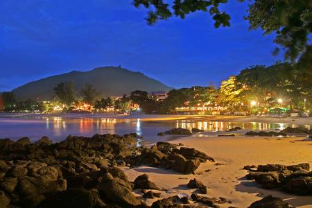 Dusk falls on a tropical beach resort in Phuket, Thailand photo