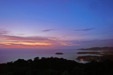 The sun sets over remote beaches on the island of Phuket, Thailand Stock Photo - 1640122