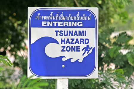 A tsunami warning sign located near a beach in Phuket, Thailand Stock Photo - 1907286