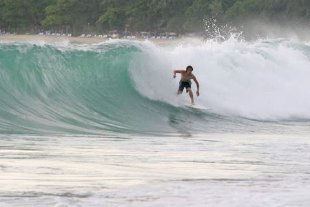 A surfer drops into a hollow wave in South East Asia Stock Photo - 2100547
