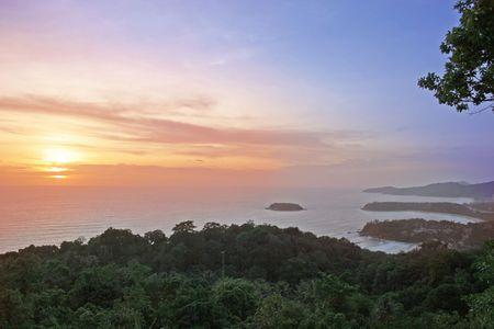 Sunset over secluded bays on the island of Phuket,Thailand photo