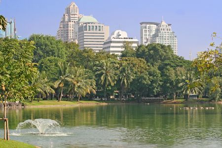 lumpini: Lumpini Park and Lake in downtown Bangkok, with modern apartments in the background Stock Photo