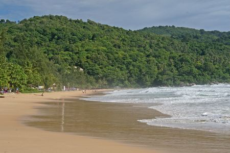A remote beach and tropical rainforest on Phuket Island, Thailand photo
