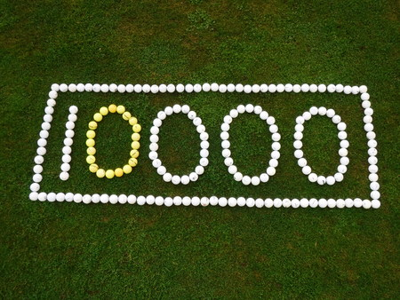 10000 spelled out in golf balls