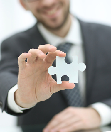 copartnership: Jigsaw puzzle in the businessman hand