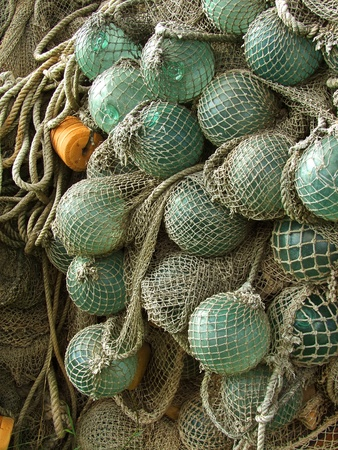 glass float, old fishing nets catch closeup Stock Photo - 13115670