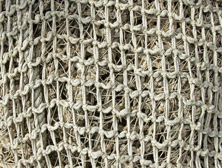 fishing nets: old decrepit rope fishing nets equipment closeup