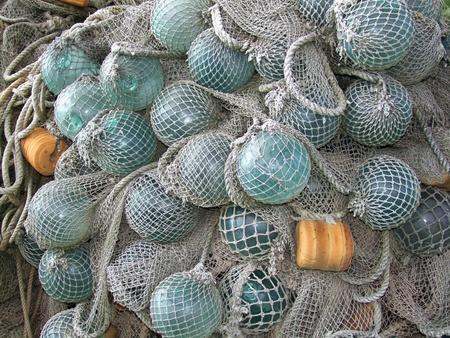 glass float, old fishing nets catch closeup