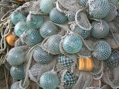 glass float, old fishing nets catch closeup photo